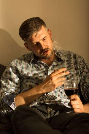 abuser: Despair man smoking cigarette and drinking wine