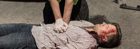 the unconscious: Policeman is doing first aid unconscious man