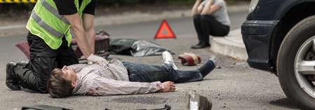 the unconscious: Policeman is doing heart massage unconscious man