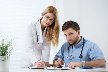 physicians: Two young experienced physician at work