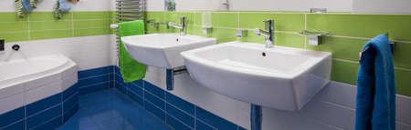 basins: Two white basins in contemporary stylish bathroom