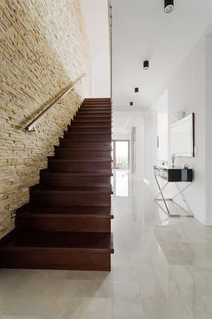luxury house: One-storey house with wooden stairs in hallway Stock Photo