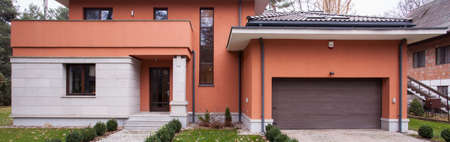 garage on house: Panoramic view of contemporary detached house with a garage