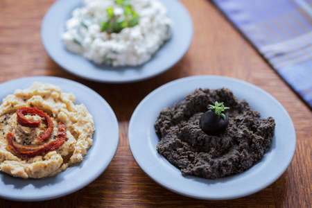 plates of food: Three delicious food pastes on the plates
