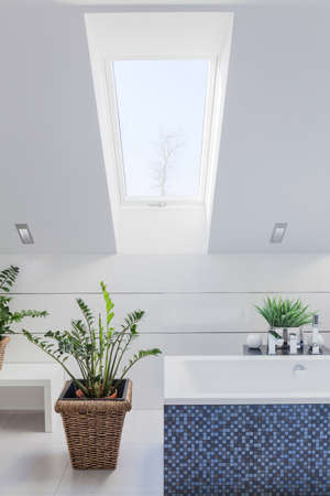 inclined: New white bright bathroom with inclined wall