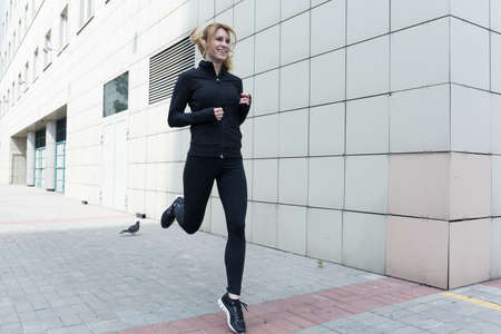 jogging: Image of a young slim lady keeping fit Stock Photo