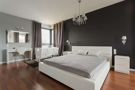 luxury bedroom: Big comfortable double bed in elegant classic bedroom