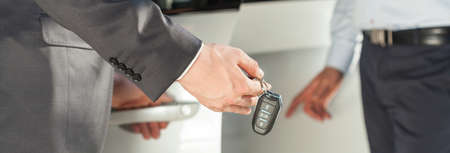 drive car: Close-up of man in suit with car keys in hand