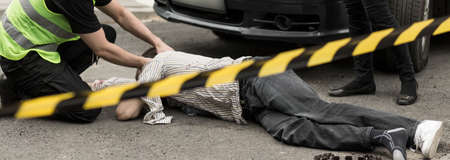 danger accident: Car crash area surrounded by warning tape Stock Photo