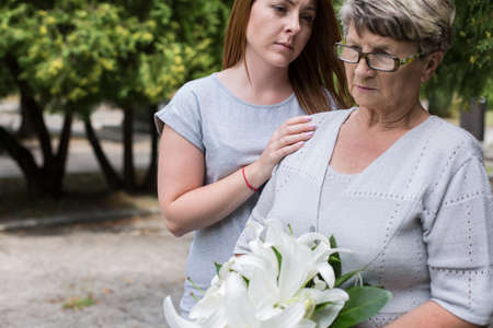 sad old woman: Picture of caring granddaughter supporting her sad grandma Stock Photo