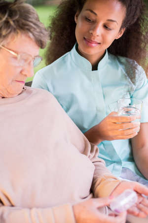 medicament: Vertical view of senior woman taking medicament Stock Photo