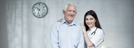 practitioner: Smiling elder man with female practitioner - panorama Stock Photo