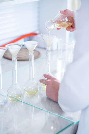 pharmacy technician: Close-up of chemistry experiment in science laboratory