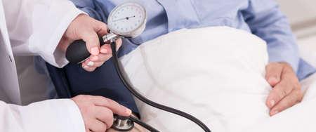 blood pressure gauge: Close-up of nurses hands holding blood pressure gauge