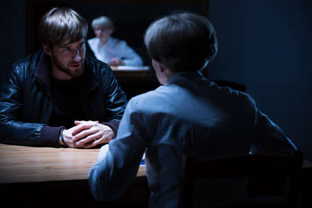 Picture of police interrogation in a dark room