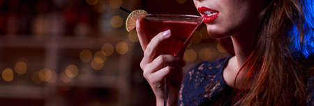 cocktail dress: Close up of attractive woman with a drink Stock Photo