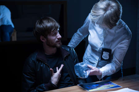 Bearded man during examination in interrogation room