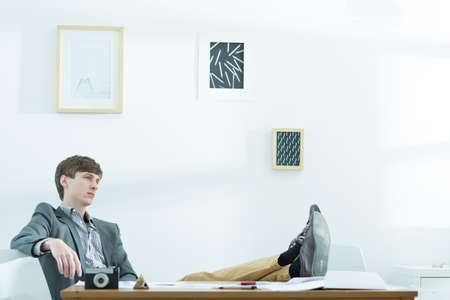 Young male designer taking break at work