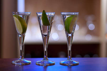 shaken: Photo of three drinks with lime standing on bar Stock Photo