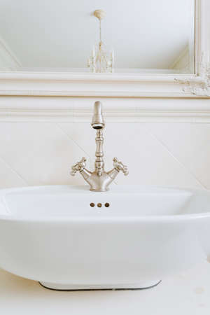 handbasin: Stylish washbowl in the bathroom of the storey house