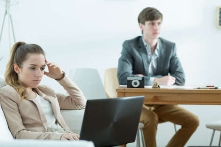 woman chair: Horizontal view of bored businesspeople at work