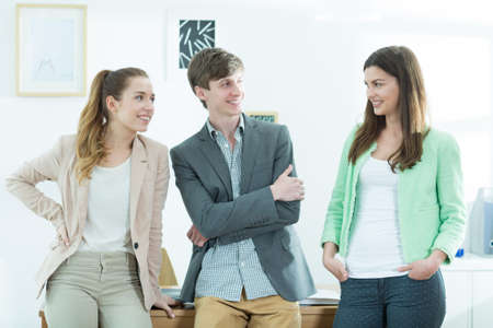 attractive woman: Group of smiling talking students - horizontal view Stock Photo
