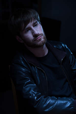jacked: Young lazy bearded man in leather jacket Stock Photo