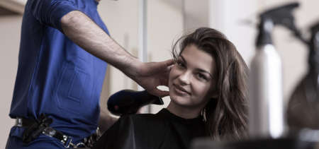 Young beauty woman relaxing in hairdresser's salon