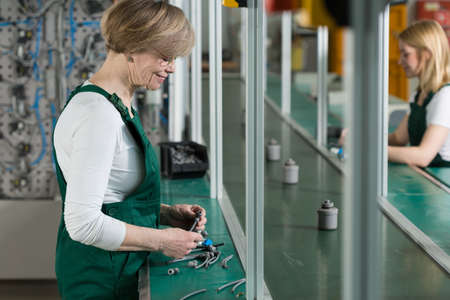 feminist: Young and old women are doing their job in the factory