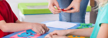children art: Children enjoy art lesson with creative teacher at kindergarten Stock Photo