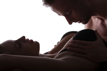 Aroused man caressing and groping womans breasts