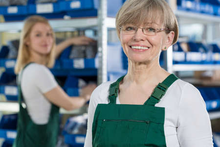 manufacture: Female blue-collar worker is fulfilled with her work