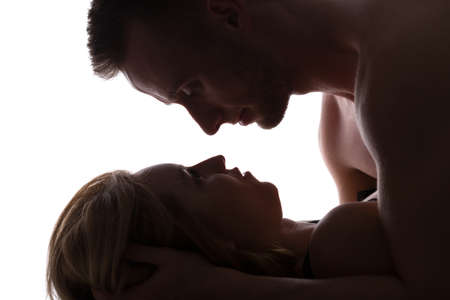 romance sex: Erotic couple in bed having passionate sex