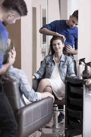 Beauty woman sitting on the chair at hair salon Stock Photo
