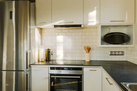 White brick wall in contemporary designed kitchen