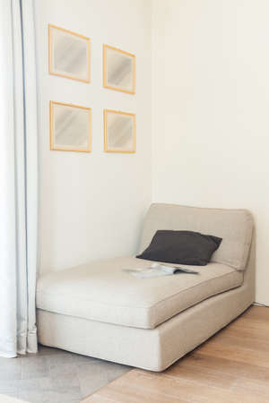 daybed: Comfortable beige couch in beige simply interior
