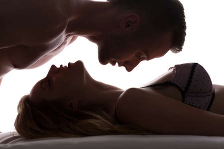 sensual sex: Sexy love couple in bed having foreplay