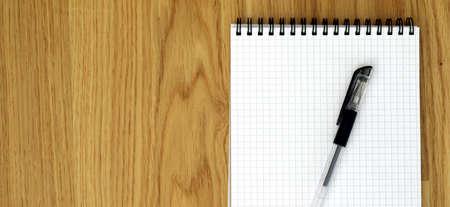 bird eye view: Bird eye view of empty notebook and pen