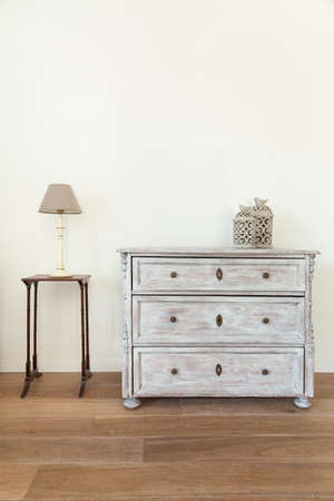 Commode and table in retro style house Standard-Bild