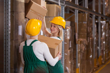 warehouse: Women are taking packages from the warehouse for export