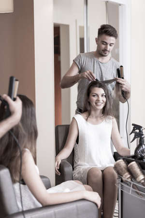 barber: Beauty woman styling hair in barber shop Stock Photo