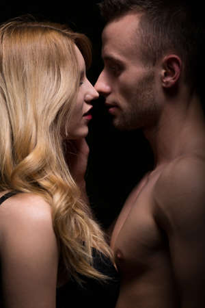nude blonde woman: Naked romantic young couple caressing and kissing