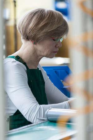 discreet: Discreet portrait of senior lady focused on her job