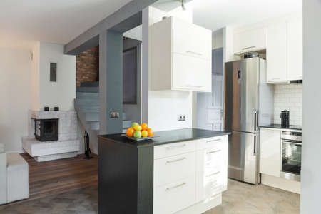 designed: Designed open kitchen and drawing room interior Stock Photo