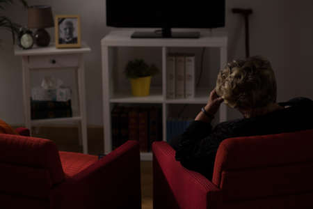 Lonely senior woman being alone at home Stock Photo