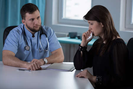 convey: Young doctor has to convey bad news to the woman