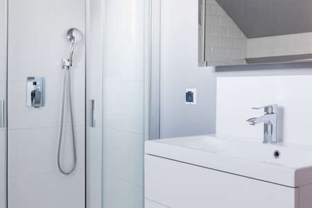 wash basin: Shower and wash basin in white toilet