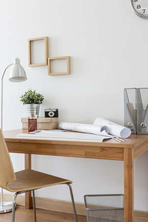 image style: Image of simple wooden desk and chair in home office