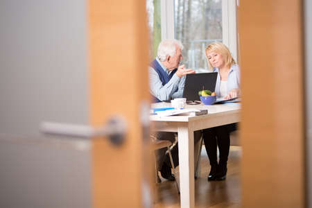Two elderly businesspeople talking about work Stock Photo