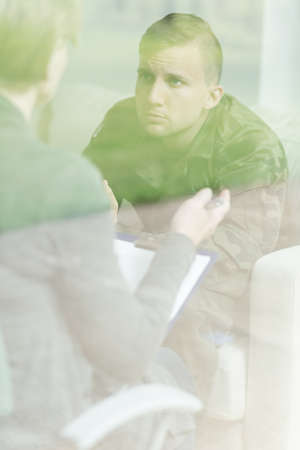 needing: Young soldier needing psychological therapy after war Stock Photo